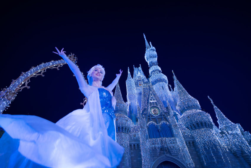 "Queen Elsa from ""Frozen"" Transforms Cinderella Castle in"